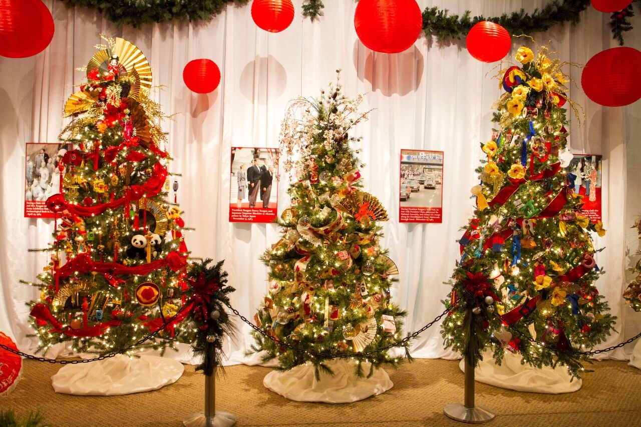 the featured tree is an elegant reproduction of president and mrs reagans white house tree complete with reagan red decorations and dozens of hand blown - Library Christmas Decorations