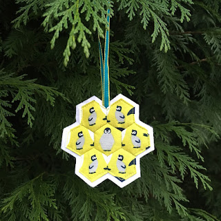penguin christmas decoration hanging on tree