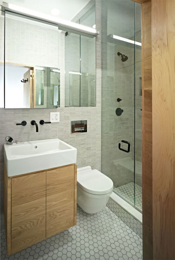 Photo of bathroom interiors showing modern shower cabin