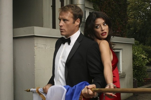 Mark Valley is living every guy's dream: being handcuffed to Emmanuelle Vaugier.