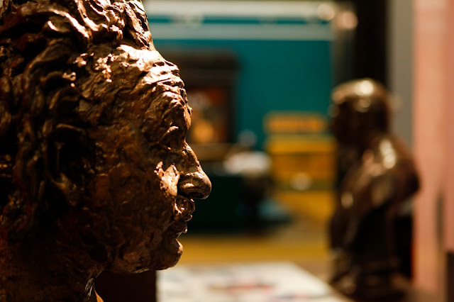 Gold Sculpture of Albert Einstein's head in Birmingham art gallery.