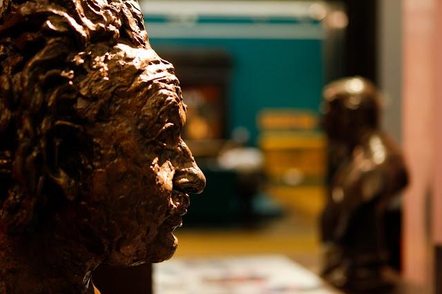 Gold Sculpture of Albert Einstein's head in Birmingham art gallery.