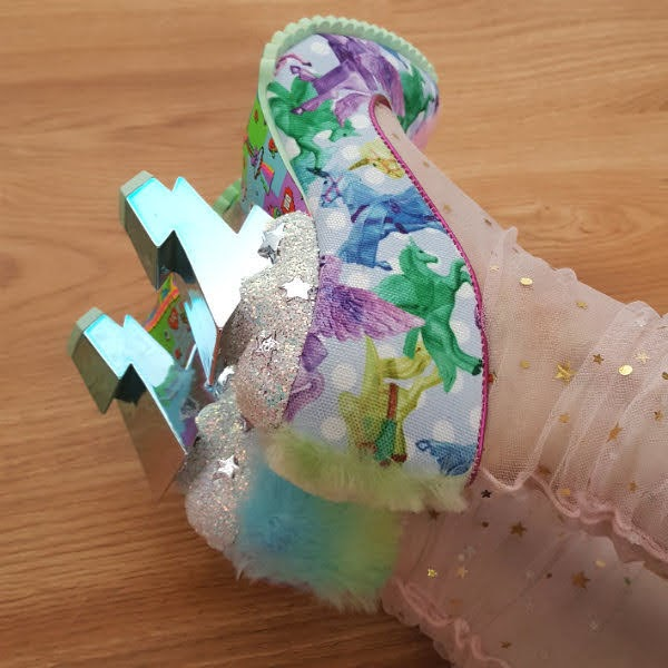 close up of cloud and lightning bolt ombre metallic heels on shoes worn with tulle socks