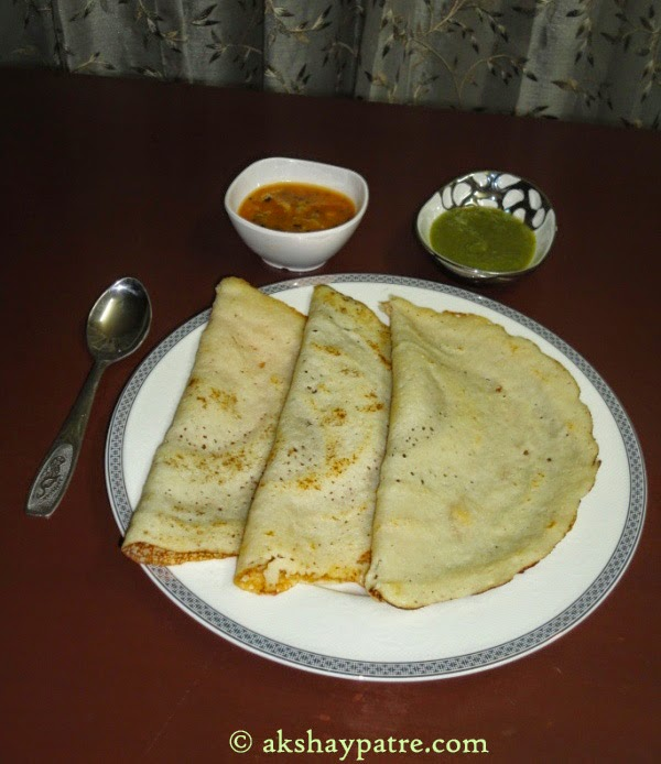 Dosa in serving plate with chutney and sambar