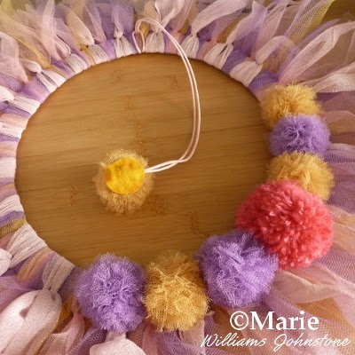 Pom poms in different colors used as decorations