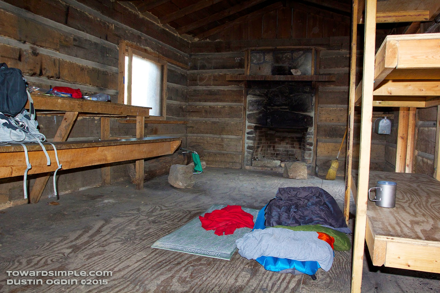 view of Hobbs Cabin with bunks and fireplace