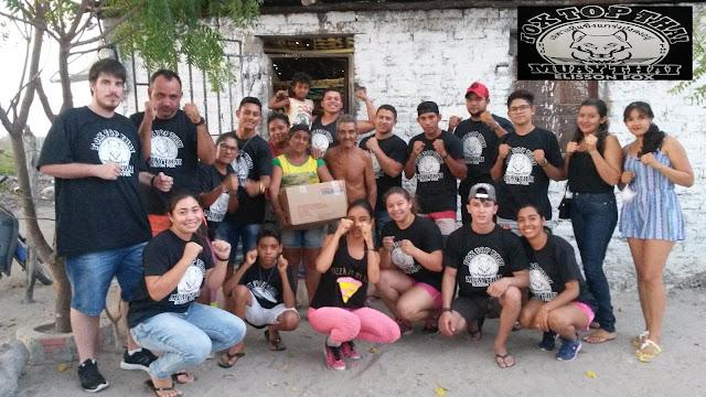Natal Feliz: Elisson Fox Muaythai e integrantes da academia fazem doações de cestas básicas para famílias de Anapurus.