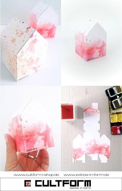 Die Hausbox von Cultform. Ein eindruchsvolles und doch einfaches DIY: kleine Geschenke individuell modern verpacken im aktuellen Watercolor-Trend: Wasserfarbvariante mit Pinsel, Rot, Anleitung