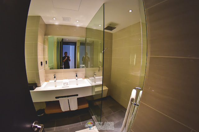 The interior of Maxims Genting Hotel Toilet - Got a big shower room with two basins and grooming table