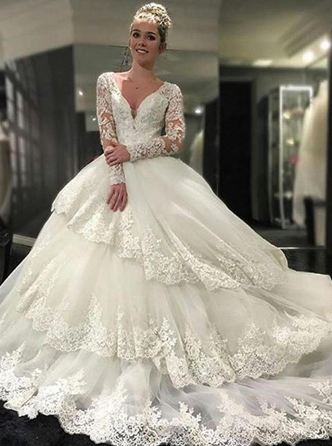 https://www.simple-dress.com/decent-v-neck-tiered-long-sleeves-wedding-dress-with-appliques-lace-top-backless.html