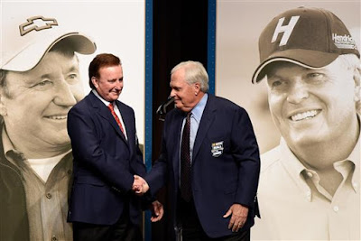Richard Childress (left) and Rick Hendrick shake hands after receiving their Hall of Fame jackets.  (Photo by Jared C. Tilton/Getty Images)
