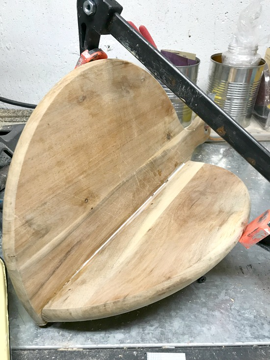broken cutting board in clamps