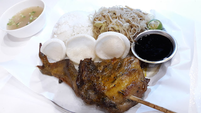Inasal Combustion.  Chicken Pecho Inasal with soup, crackers, rice and pancit.