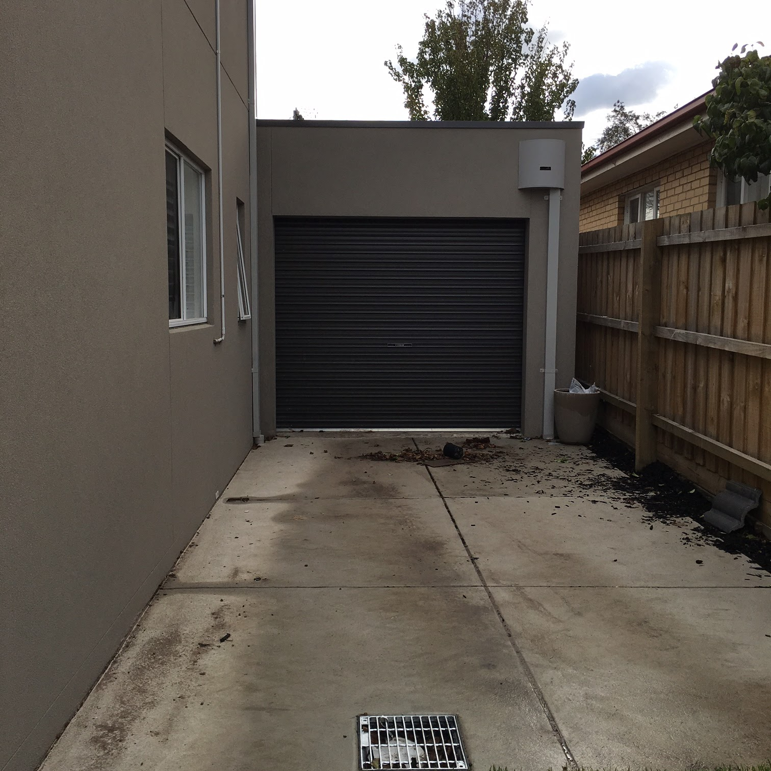 Concreting and shutters building the charlton by porter for Rear garage door
