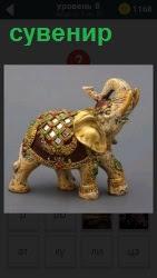 Статуэтка слона с поднятым хоботом в качестве сувенира, можно увидеть в магазине или на выставке
