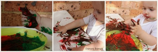 Squeezing, squelching, oozing finger paint between baby fingers