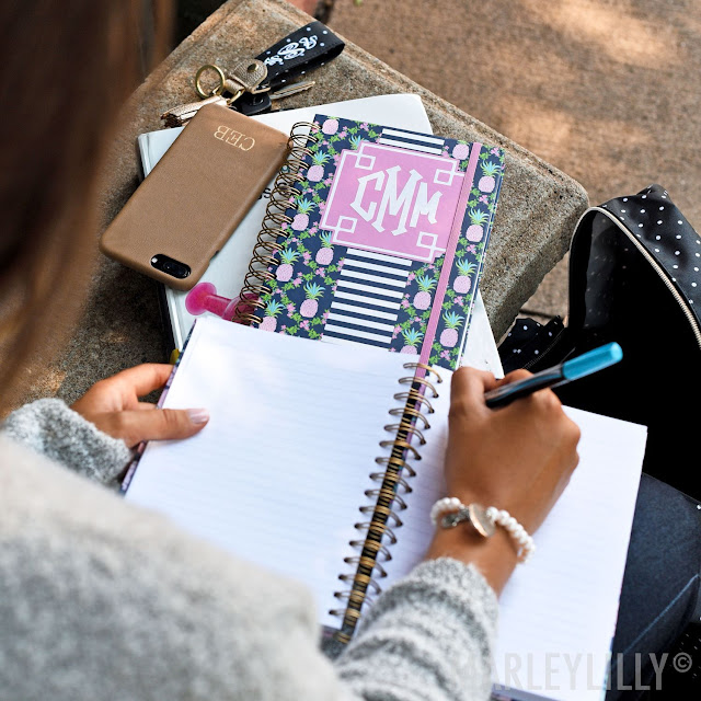 girl writing in personalized notebook