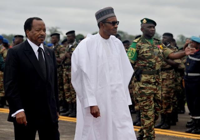 cameroonian president paul biya walks nigerian president muhammadu buhari