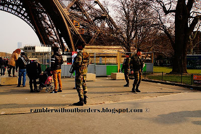 armed militia outside the Eiffel Tower