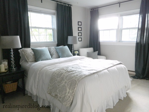 I love long flowy gray curtains in my gray master bedroom, and my favorite curtain hanging method is a curtain rod and ring clips.Obviously, ring clips aren't the only way to hang curtains but there are three reasons why this curtain hanging style is my favorite...