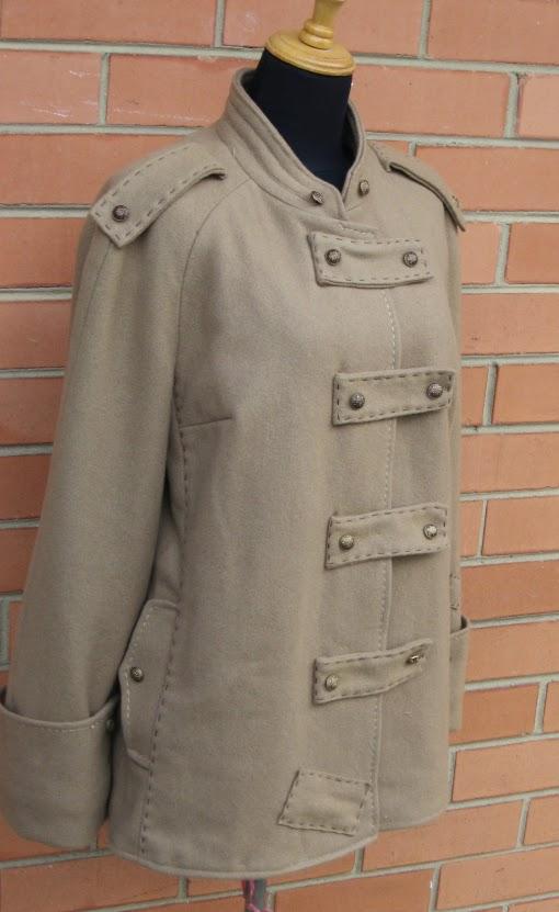 http://makebakesisters.wordpress.com/2012/07/28/the-epic-coat-refashion/