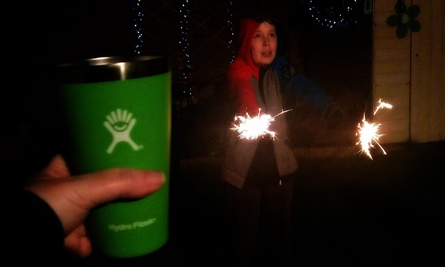 Boy with sparklers, featuring Hydro Flask True Pint cup in foreground.