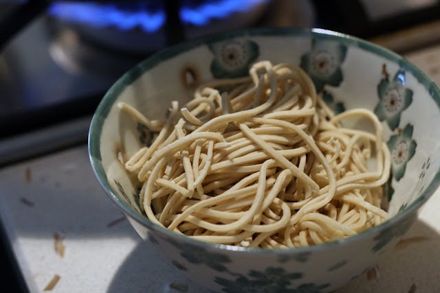 A bowl of uncooked ramen noodles.