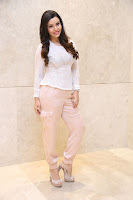 Kyra Dutt in Tight White Top Trousers at Paisa Vasool audio success meet ~  Exclusive Celebrities Galleries 041.JPG
