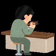 カウンターでラーメンを食べる人のイラスト