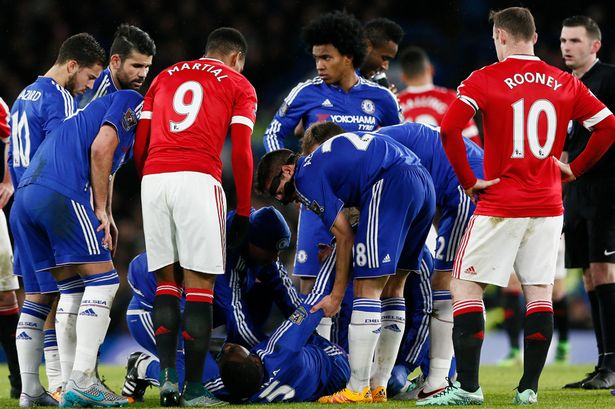 Concern: Zouma lies on the ground in pain at Stamford Bridge