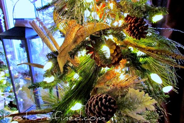 Decorating a Christmas Tree with a woodland theme