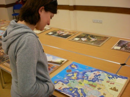 Emily perusing a puzzle at JigFest 2012