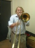 picture of Volker Mueller playing trombone at mekong pirates practice room in Phnom Penh Cambodia