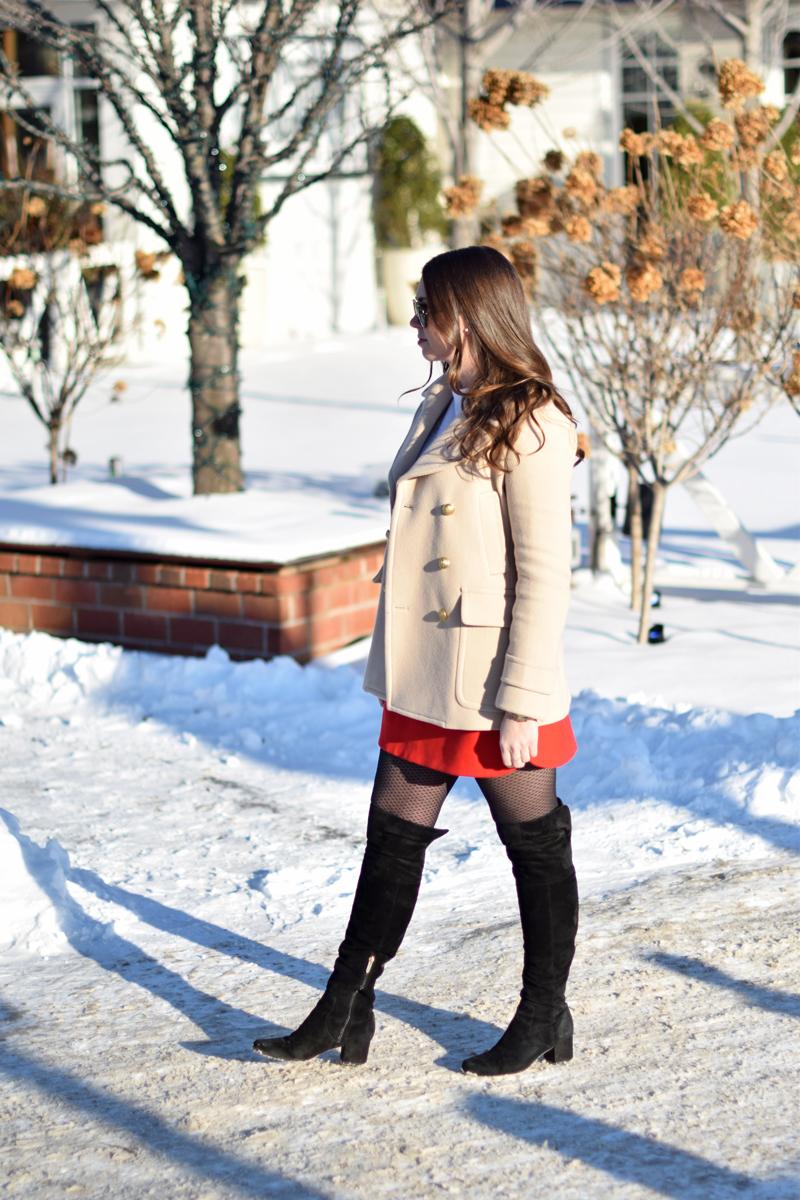 Stylish winter wear on woman walking in the snow.