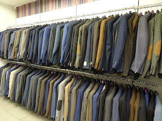 row of tailor made suits slaters glasgow