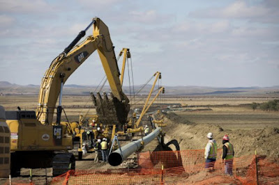 bulldozer and pipeline construction in North Dakota