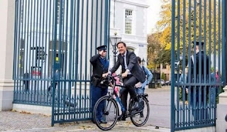 Netherlands Prime Minister rides a bi-cycle to his office