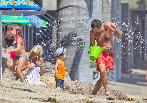 Tori Spelling with family at the beach in Malibu