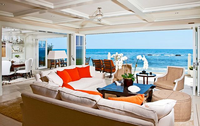 Light slipcover sofa facing an ocean view