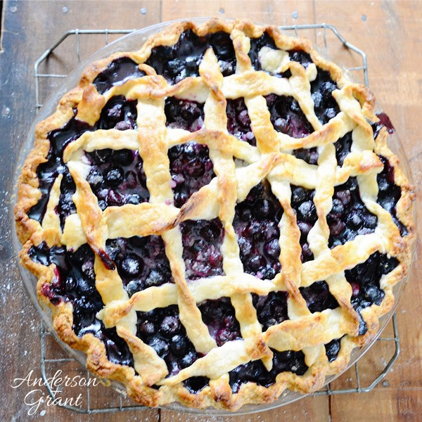 Top of blueberry pie on wire rack