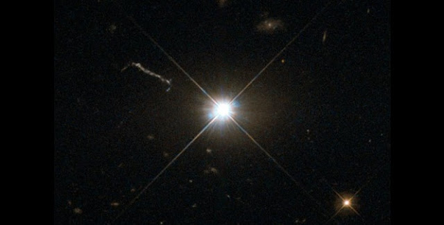 Optical image of the quasar 3C 273 (the bright stellar-like object in the center) obtained with the Hubble Space Telescope. It was the first quasar ever to be identified. Credit: NASA