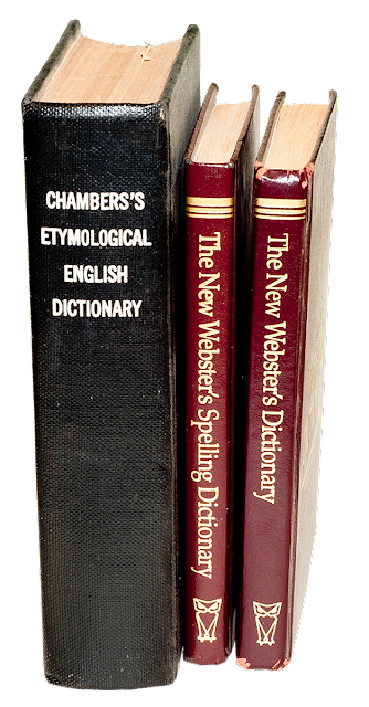 Three different dictionaries; a Chambers, a Webster's and a Spelling dictionary.