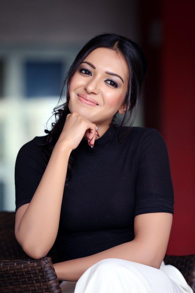 Telugu Girl Catherine Tresa Latest Photo shoot In Blue Top White Pant