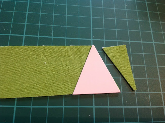 triangle template on strip of fabric