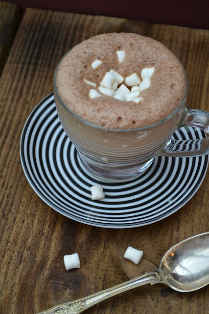 A cup of Real Spiced Hot Chocolate topped with mini vegan marshmallows
