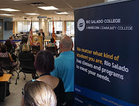 image of opening ceremony with guests.  In foreground is a sign that reads: No matter what kind of student you are, Rio Salado has classes and programs to meet your needs.