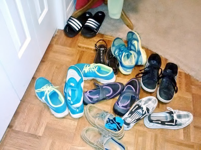 Shoe pile up in the foyer #clutter #organization #help