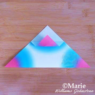Folding triangle paper