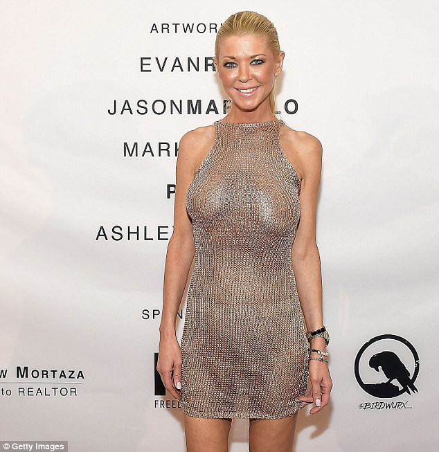 Tara-Reid-flashes-her-boobs-in-braless-dress