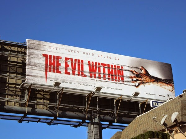 Evil Within clawing barbed wire hand billboard